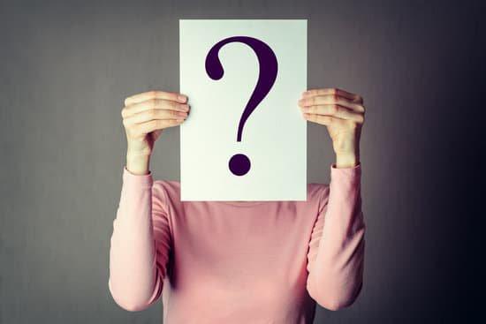 Person hiding face behind a question mark